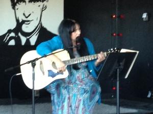 Anyah playing guitar