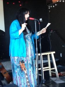Anyah reading poetry